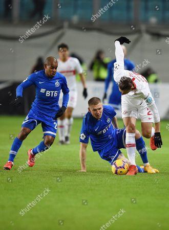 Left to right: players of Dynamo Joaozinho, Evgeny Lutsenko and Ilya Kutepov of Spartak during the match.