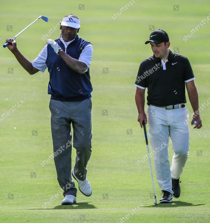 Vijay Singh of Fiji (L) and Francesco Molinari of Italy (R) walk up the eighteenth fairway during practice for THE PLAYERS Championship golf tournament on the Stadium Course at TPC Sawgrass in Ponte Vedra Beach, Florida, USA, 13 March 2019. The tournament runs from 14 to 17 March.