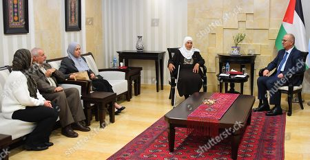 Stock Picture of Former Palestinian Prime Minister, Rami Hamdallah, meets with the family of the prisoner Maher Younes, in the West Bank city of Ramallah