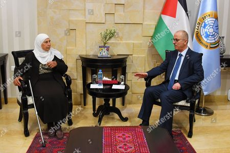 Former Palestinian Prime Minister, Rami Hamdallah, meets with the family of the prisoner Maher Younes, in the West Bank city of Ramallah