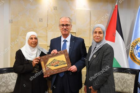 Stock Image of Former Palestinian Prime Minister, Rami Hamdallah, meets with the family of the prisoner Maher Younes, in the West Bank city of Ramallah