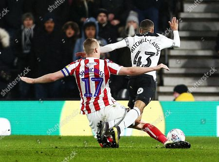 Ryan Shawcross of Stoke City brings down Jayden Mitchell-Lawson of Derby County for a free kick