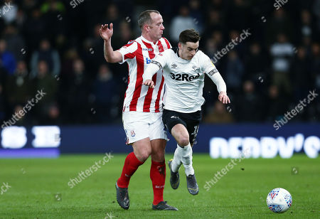 Tom Lawrence of Derby County and Charlie Adam of Stoke City