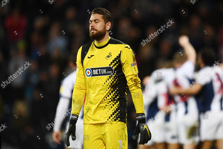 Goal keeper Kristoffer Nordfeldt of Swansea City shows a look of dejection after the 3rd goal.