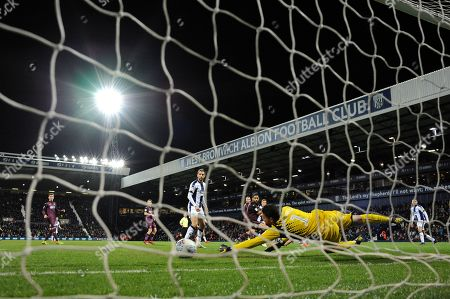 Goal keeper Kristoffer Nordfeldt of Swansea City makes a save from a Dwight Gayle of West Bromwich Albion shot.