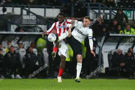 Derby County defender Richard Keogh (6) and Stoke City forward Mame Biram Diouf (18) during the EFL Sky Bet Championship match between Derby County and Stoke City at the Pride Park, Derby