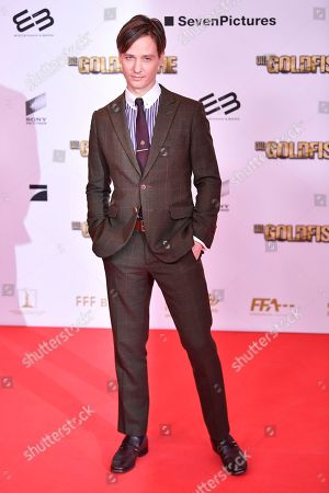 Tom Schilling poses on the red carpet before the 'Die Goldfische' movie premiere in Munich, Germany, 13 March 2019.