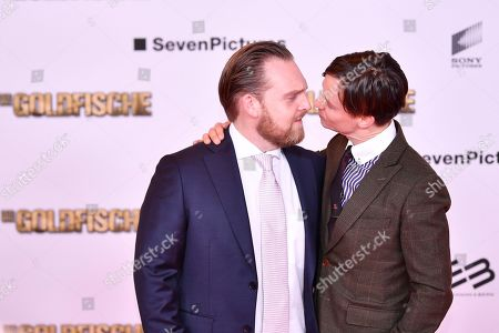 Tom Schilling (R) and Axel Stein (L) pose on the red carpet before the 'Die Goldfische' movie premiere in Munich, Germany, 13 March 2019.