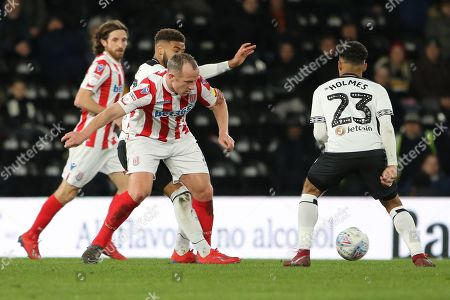 Stoke City midfielder Charlie Adam wins the ball during the EFL Sky Bet Championship match between Derby County and Stoke City at the Pride Park, Derby