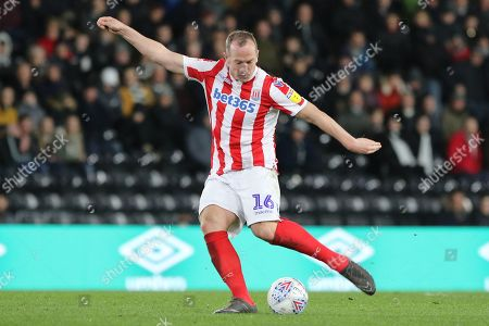Stoke City midfielder Charlie Adam strikes the ball during the EFL Sky Bet Championship match between Derby County and Stoke City at the Pride Park, Derby