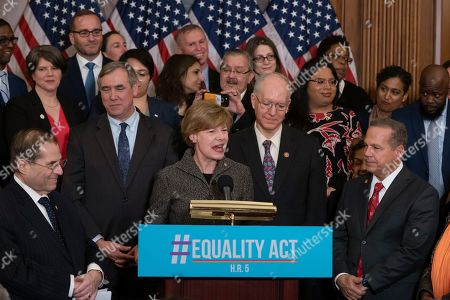Tammy Baldwin, Jerrold Nadler, David Cicilline. Sen. Tammy Baldwin, D-Wis., flanked by House Judiciary Committee Chairman Jerrold Nadler, D-N.Y., left, and Rep. David Cicilline, D-R.I., right, joins fellow Democrats as they announce the introduction of The Equality Act, a comprehensive nondiscrimination bill for LGBT rights, at the Capitol in Washington, . Baldwin, an LGBT rights activist, was the first openly gay woman elected to the Senate