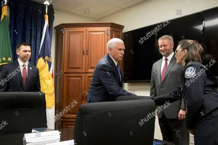 Vice President Mike Pence, second from left, accompanied by U.S. Customs and Border Protection Commissioner Kevin McAleenan, left, greets Customs and Border Protection Office of Training and Development Assistant Commissioner Chris Hall, second from right, and Customs and Border Protection Advanced Training Center Acting Director Maria Otero, right, as he arrives for a briefing at the U.S. Customs and Border Protection Advanced Training Facility in Harpers Ferry, W.Va