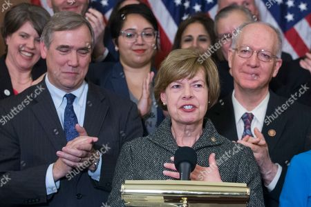 Democratic Senator from Wisconsin and the first openly-gay person elected to the US Senate, Tammy Baldwin (R), speaks beside Democratic Senator from Oregon Jeff Merkley (L) and other lawmakers and supporters at an event held to introduce the Equality Act, on Capitol Hill in Washington, DC, USA, 13 March 2019. The Equality Act, which has been applauded by members of the LGBTQ community, is legislation that would amend the Civil Rights Act of 1964 to prohibit discrimination on the basis of sexual orientation and gender identity 'in education, employment, housing, credit, federal jury service, public accommodations, and the use of federal funds'.