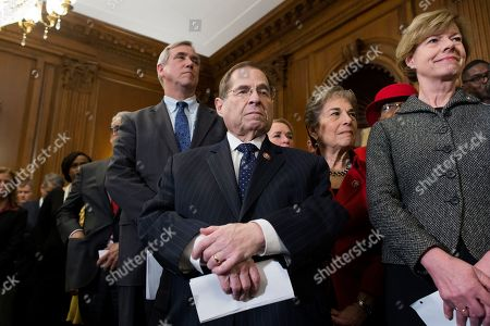 Democratic Representative from New York and Chairman of the House Judiciary Committee Jerry Nadler (C) joins  Democratic Senator from Wisconsin Tammy Baldwin (R),  Democratic Senator from Oregon Jeff Merkley (Back L) and other lawmakers and supporters during at an event held to introduce the Equality Act on Capitol Hill in Washington, DC, USA, 13 March 2019. The Equality Act, which has been applauded by members of the LGBTQ community, is legislation that would amend the Civil Rights Act of 1964 to prohibit discrimination on the basis of sexual orientation and gender identity 'in education, employment, housing, credit, federal jury service, public accommodations, and the use of federal funds'.