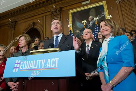 Democratic Senator from Oregon Jeff Merkley (C) delivers remarks during at an event held to introduce the Equality Act, beside Democratic Senator from Wisconsin Tammy Baldwin (L) and US Speaker of the House Democrat Nancy Pelosi (R), on Capitol Hill in Washington, DC, USA, 13 March 2019. The Equality Act, which has been applauded by members of the LGBTQ community, is legislation that would amend the Civil Rights Act of 1964 to prohibit discrimination on the basis of sexual orientation and gender identity 'in education, employment, housing, credit, federal jury service, public accommodations, and the use of federal funds'.