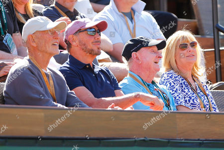 Rod Laver watches Roger Federer in action next to Larry Ellison