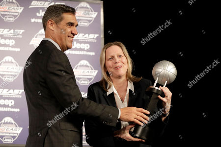 Villanova head coach Jay Wright, left, receives the Big East Conference coach of the year award from commissioner Val Ackerman prior to the start of the NCAA Big East men's college basketball tournament, in New York