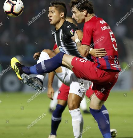 Cerro's Fernando Amorebieta (R) vies for the ball with Zamora's Guillermo Paiva during their Copa Libertadoers group E soccer match between Club Cerro Porteno of Paraguay and Zamora of Venezuela,at General Pablo Rojas stadium in Asuncion, Paraguay, 13 March 2019.