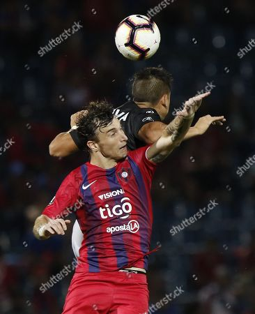 Stock Image of Cerro's Fernando Amorebieta (L) vies for the ball with Zamora's Guillermo Paiva during their Copa Libertadoers group E soccer match between Club Cerro Porteno of Paraguay and Zamora of Venezuela, at General Pablo Rojas stadium in Asuncion, Paraguay, 13 March 2019.
