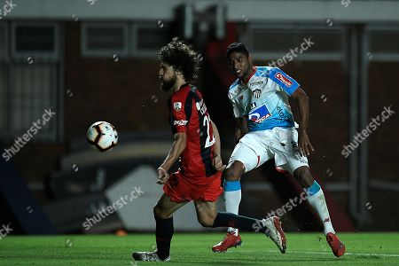 San Lorenzo's Fabricio Coloccini (L) vies for the ball with Junior's Luis Ruiz during the Copa Libertadores group F soccer match between San Lorenzo and Atletico Junior at Pedro Bidegain stadium in Bueos Aires, Argentina, 13 March 2019.