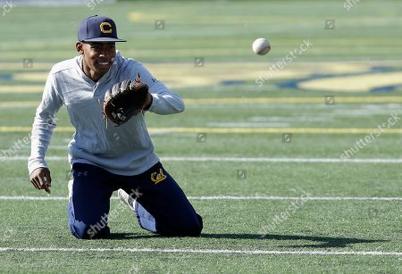 California's Darren Baker fields a ball during NCAA college baseball practice in Berkeley, Calif