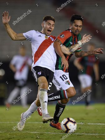 Stock Picture of Gonzalo Montiel of Argentina's River Plate and Luis Jimenez of Chile's Palestino vie for the ball during a Copa Libertadores Group A soccer match at the Antonio Vespucio Liberti stadium in Buenos Aires, Argentina, . The game was played in an empty, closed door stadium, mandated by the South American Soccer Confederation as punishment for River Plate fans attacking Boca Juniors' bus prior to the final of the Copa Libertadores 2018, which was suspended