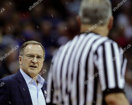 Oklahoma coach Lon Kruger talks to an official during the first half of the team's NCAA college basketball game against Oklahoma in the Big 12 men's tournament, in Kansas City, Mo