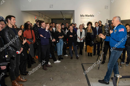 """Former NASA astronaut, Mike Massimino, right, shares his unique perspective on """"blu Marble"""" at unveiling powered by blu on in New York"""