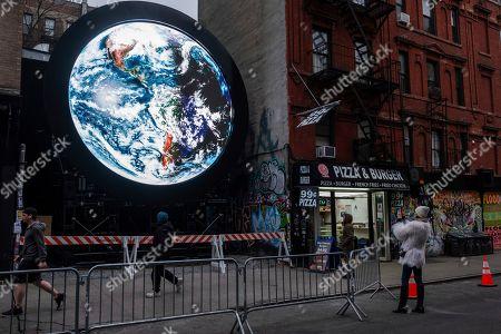 "NY public art installation ""blu Marble"" is unveiled by Sebastian Errazuriz and Pledge World by blu on in New York"