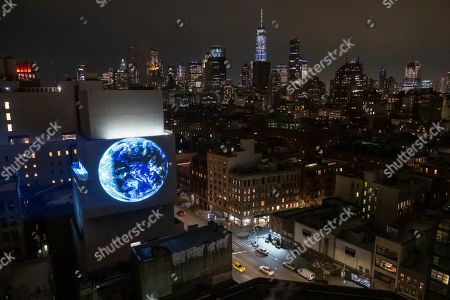 """One night only projection of Sebastian Errazuriz's """"blu Marble"""" made possible by Pledge World by blu on in New York"""