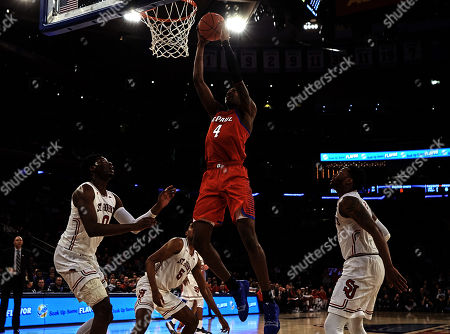 Piscataway, New Jersey, U.S. - DePaul Blue Demons forward Paul Reed (4) scores underneath the basket in the second half during first round Big East Conference Tournament between the DePaul Blue Demons and St Johns Red Storm at Madison Square Garden in New York City. St Johns defeated DePaul 82-74