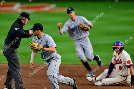 Stock Picture of Cory Wood, Scott McKeon, Logan Davidson. Coastal Carolina's Cory Wood, left, and Scott McKeon, center, react after tagging Clemson's Logan Davidson, right, out at second base during an NCAA college baseball game, in Clemson, S.C