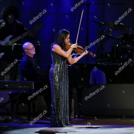 Violinist Sarah Chang performs on stage during the Library of Congress Gershwin Prize tribute concert held at DAR Constitution Hall, in Washington