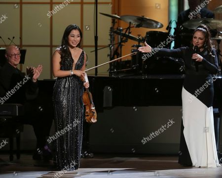 Sarah Chang, Gloria Estefan. Violinist Sarah Chang, left, and award recipient Gloria Estefan perform on stage during the Library of Congress Gershwin Prize tribute concert held at DAR Constitution Hall, in Washington