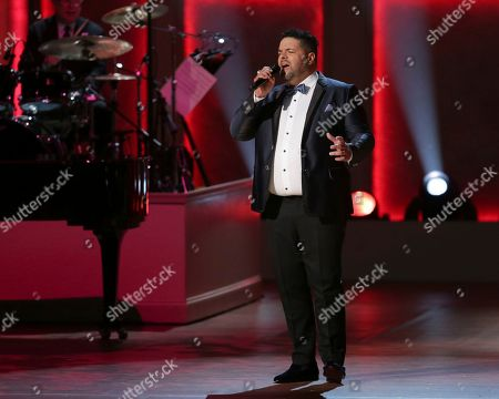 Tenor Fernando Varela performs on stage during the Library of Congress Gershwin Prize tribute concert held at DAR Constitution Hall, in Washington