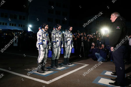 Russian cosmonaut Alexey Ovchinin (2-L), NASA astronauts Christina Koch (L) and Nick Hague (3-L) report to the Dmitry Rogozin (R) the Director General of Russian Space agency Roscosmos before launch of the Soyuz MS-12 spacecraft at the Russian leased Baikonur cosmodrome, Kazakhstan, 14 March 2019. Russian cosmonaut Alexey Ovchinin, NASA astronauts Christina Koch and Nick Hague will launch on 14 March aboard the Russian Soyuz MS-12 spacecraft from the Baikonur Cosmodrome in Kazakhstan for a six-and-a-half-month mission on the International Space Station.