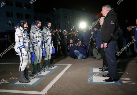 Russia's Roscosmos space agency chief Dmitry Rogozin, right, greets U.S. astronauts Christina Hammock Koch, left, Nick Hague, third right, and Russian cosmonaut Alexey Ovchinin, members of the main crew of the expedition to the International Space Station (ISS), prior the launch of Soyuz MS-12 space ship at the Russian leased Baikonur cosmodrome, Kazakhstan