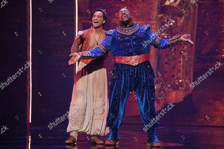 Stock Photo of The Genie [Trevor Dion Nicholas] and Aladdin [Matthew Croke]