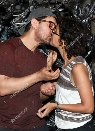 Bollywood actor Aamir Khan kisses his wife Kiran Rao as they celebrate his birthday at his residence in Mumbai, India, 14 March 2019. Aamir turned 54.