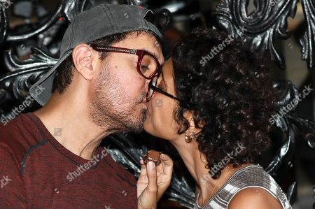 Stock Image of Bollywood actor Aamir Khan (L) kisses his wife Kiran Rao (R) after cutting his cake as he celebrates his birthday at his residence at Bandra in Mumbai, India, 14 March 2019. Aamir turned 54.