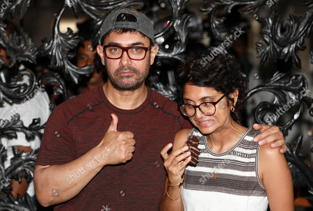 Stock Image of Bollywood actor Aamir Khan and his wife Kiran Rao celebrate his birthday at his residence at Bandra in Mumbai, India, 14 March 2019. Aamir turned 54.