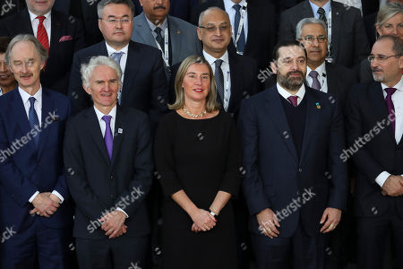 Federica Mogherini, Saad Hariri. European Union foreign policy chief Federica Mogherini, front row center, and Lebanon's Prime Minister Saad Hariri, front row second right, pose with officials for a group photo during a Syria donors conference at the European Council headquarters in Brussels,. Senior representatives from scores of countries and international organizations gathered Thursday in a fresh effort to drum up aid for Syria amid growing donor fatigue as the conflict enters its ninth year