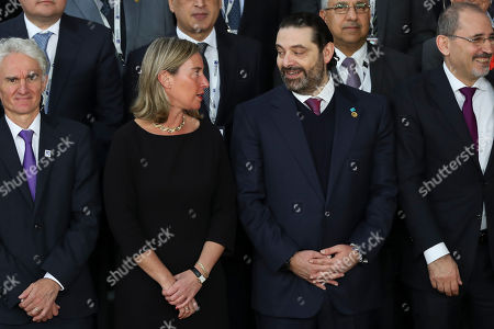 Federica Mogherini, Saad Hariri. European Union foreign policy chief Federica Mogherini, second left, talks to Lebanon's Prime Minister Saad Hariri, second right, as they pose with officials for a group photo during a Syria donors conference at the European Council headquarters in Brussels,. Senior representatives from scores of countries and international organizations gathered Thursday in a fresh effort to drum up aid for Syria amid growing donor fatigue as the conflict enters its ninth year