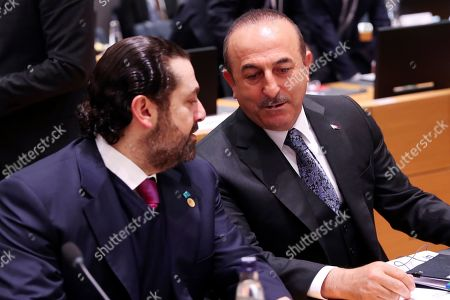"""Saad Hariri, Mevlut Cavusoglu. Turkish Foreign Minister Mevlut Cavusoglu, right, talks to Lebanon's Prime Minister Saad Hariri during a Syria donors conference at the European Council headquarters in Brussels,. The European Union's top diplomat says the EU expects """"significant pledges"""" for Syria at a donor conference, as the bloc seeks to keep the 8-year conflict in the international spotlight"""