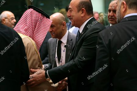 """Adel al-Jubeir, Mevlut Cavusoglu. Saudi Arabia's Foreign Minister Adel al-Jubeir, left, shakes hands with Turkish Foreign Minister Mevlut Cavusoglu during a Syria donors conference at the European Council headquarters in Brussels,. The European Union's top diplomat says the EU expects """"significant pledges"""" for Syria at a donor conference, as the bloc seeks to keep the 8-year conflict in the international spotlight"""