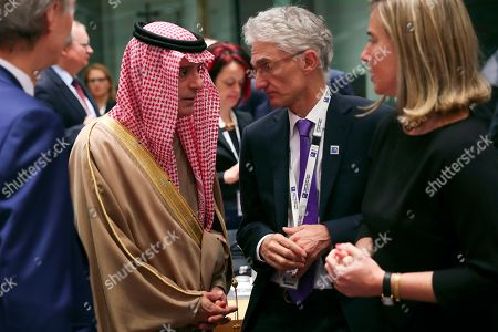 """Adel al-Jubeir, Federica Mogherini, Mark Lowcock. Saudi Arabia's Foreign Minister Adel al-Jubeir, left, talks to UN Under-Secretary-General for Humanitarian Affairs Mark Lowcock, centre, and European Union foreign policy chief Federica Mogherini, right, during a Syria donors conference at the European Council headquarters in Brussels,. The European Union's top diplomat says the EU expects """"significant pledges"""" for Syria at a donor conference, as the bloc seeks to keep the 8-year conflict in the international spotlight"""