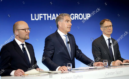 Chief Financial Officer (CFO) Ulrik Svensson (R) with Chief Executive Officer (CEO) Carsten Spohr (C) and spokesman Andreas Bartels (L) of Lufthansa AG attend the annual press conference of the Lufthansa Group in Frankfurt, Germany, 14 March 2019.