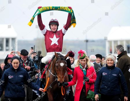 CHELTENHAM. TIGER ROLL and Keith Donoghue (with Meath Gaa scarf) led in by Anita O'Leary with grooms Karen Morgan and Louise Magee after win for trainer Gordon Elliott.