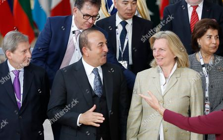 (L-R) EU Commissioner for Enlargement Negotiations Johannes Hahn, Turkish Foreign Minister Mevlut Cavusoglu and Austrian Foreign Minister Karin Kneissl talk during the Supporting the Future of Syria and the Region - Brussels III conference in Brussels, Belgium, 14 March 2019. The conference gathers 80 international delegations, more than 50 countries with the aim 'to keep Syria and the Syrian people on top of the international agenda'.