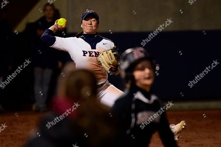 Pennsylvania's Lucy Yang can't make the throw in time to get Lafayette's Erica Hanson out at first base during an NCAA softball game on in Philadelphia. Lafayette won 5-3
